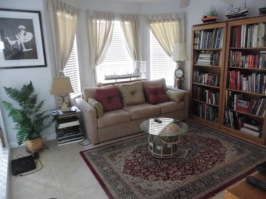 Adjacent to bedroom Sitting room for Breakfast & relaxation with flat screen TV & library .