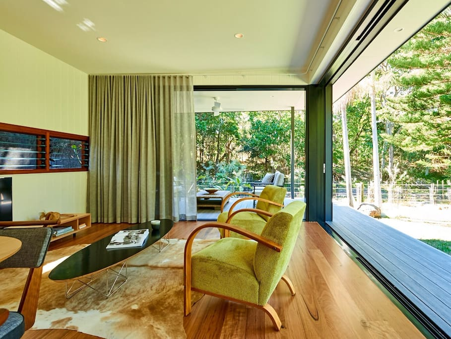 Huge beautiful glass sliding doors disappear to bring the beauty of outside in