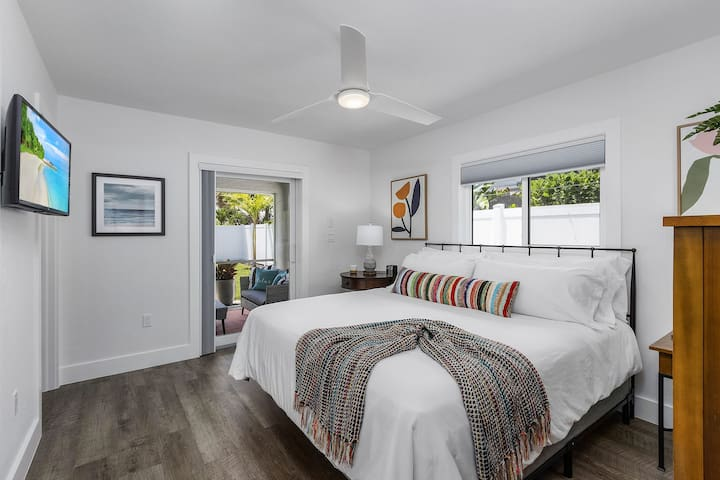 Primary bedroom, with king bed, private bathroom and private access to the patio. Smart TV and plenty of closet and dresser space for clothes storage.