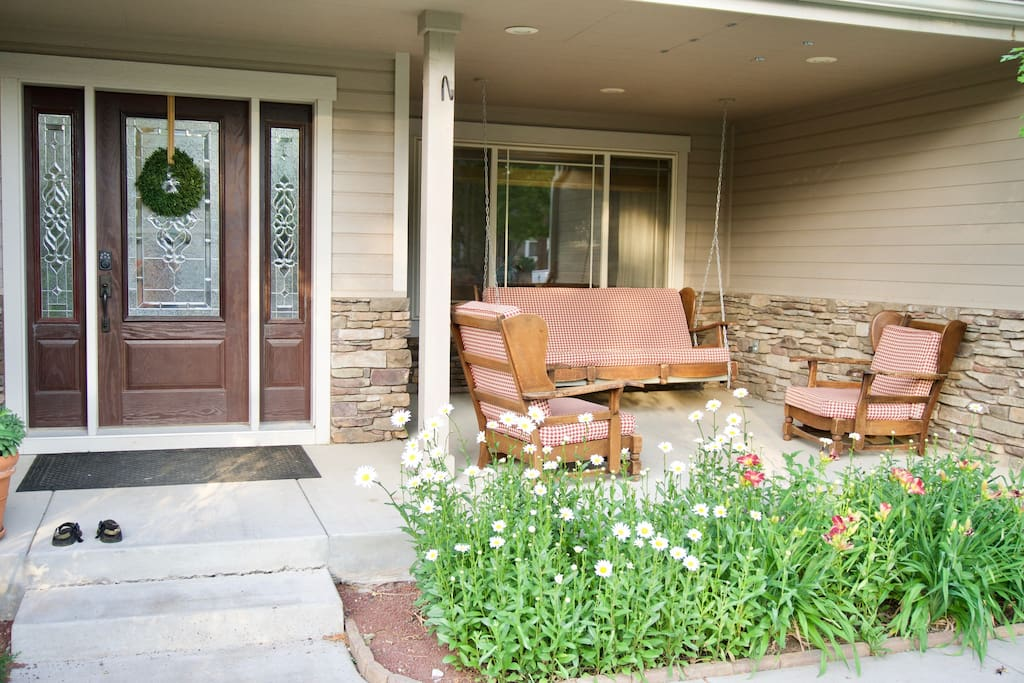 Front Door with porch swing and patio furniture