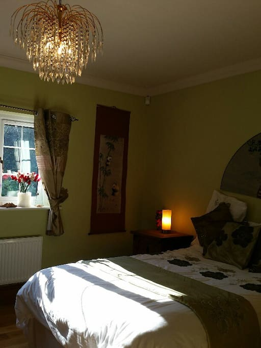 Sunny tranquil Queen-size bedroom with Solid Oak floors