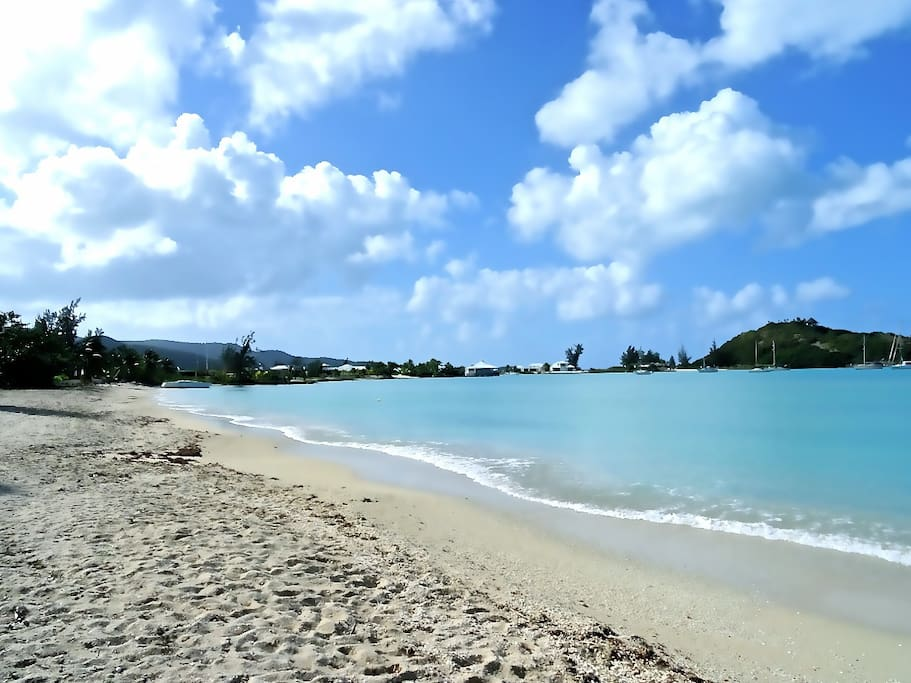 The white-sand Jolly Harbour beach and its turquoise waters are a few minutes away from the Villa.