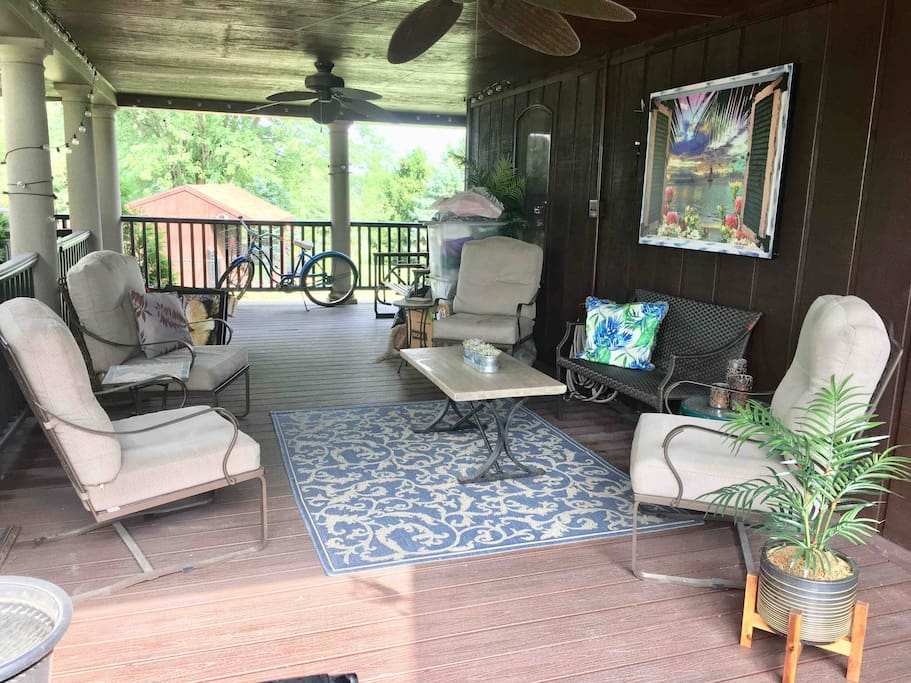 This is the entrance to the house and a great (shared) space to sit if it's raining, as this deck typically doesn't get wet.