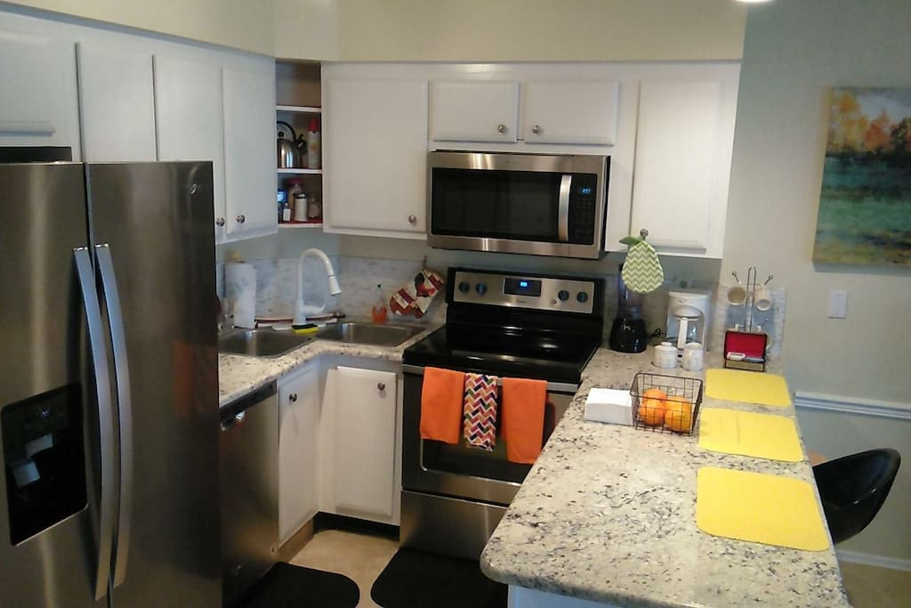 new whirlpool stainless appliances, with granite counters. Stocked for the vacation chefs!!