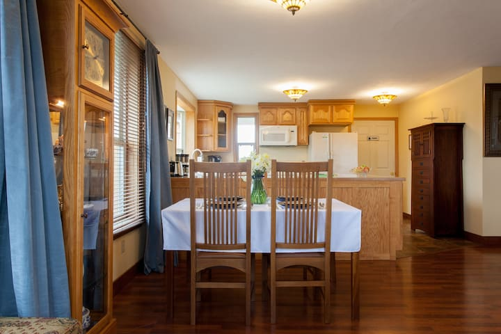 you have exclusive use of the fully-fitted dining room and kitchen.  See that door at the back of the kitchen? ...your hosts live in the 1905 farmhouse attached to the apartment!