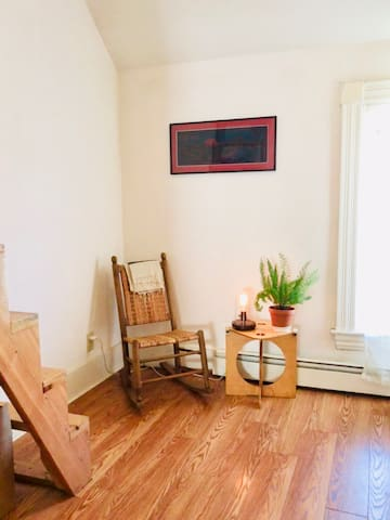 Small sitting area before heading up the stairs to the attic loft.