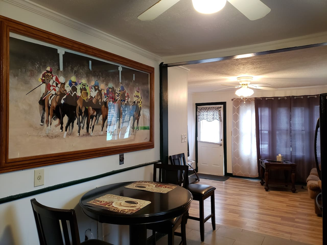 Mural by local Artist Jamie Hatfield with inspiration from a photo taken by a personal friend of the 2014 Kentucky Derby.