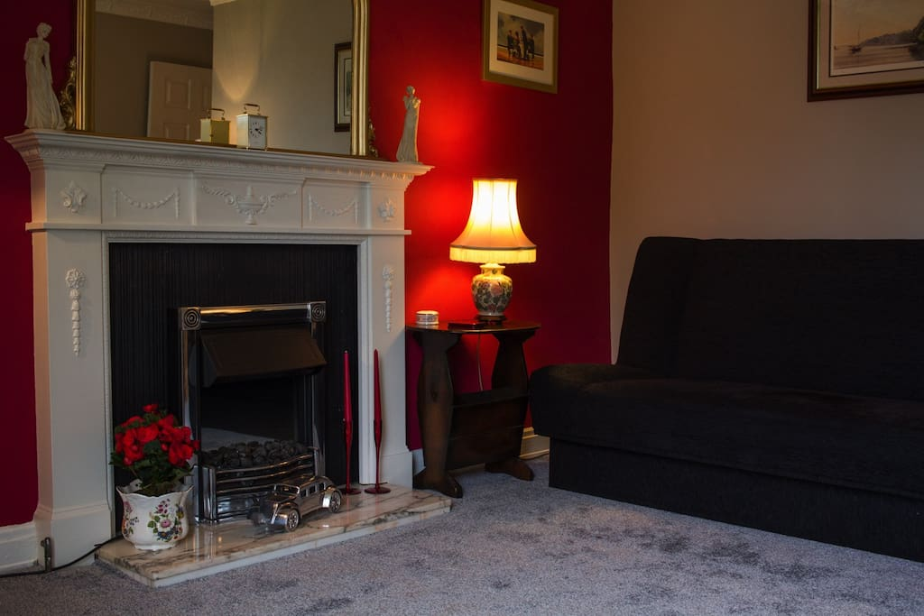 Cozy fireplace and sofabed in the lounge