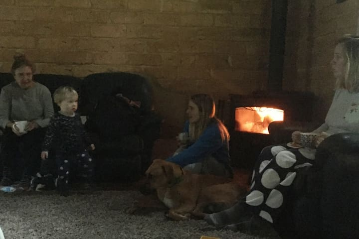 A relaxing winters morning around a warm glowing fire.