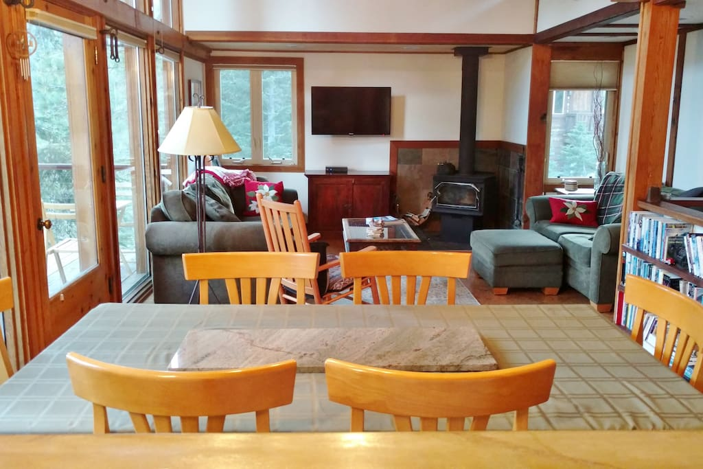 Dining area, living room, wood stove, recently updated cork flooring, flat-screen TV.