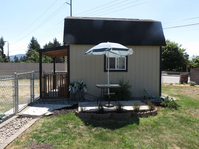 Side view, front porch and small patio area