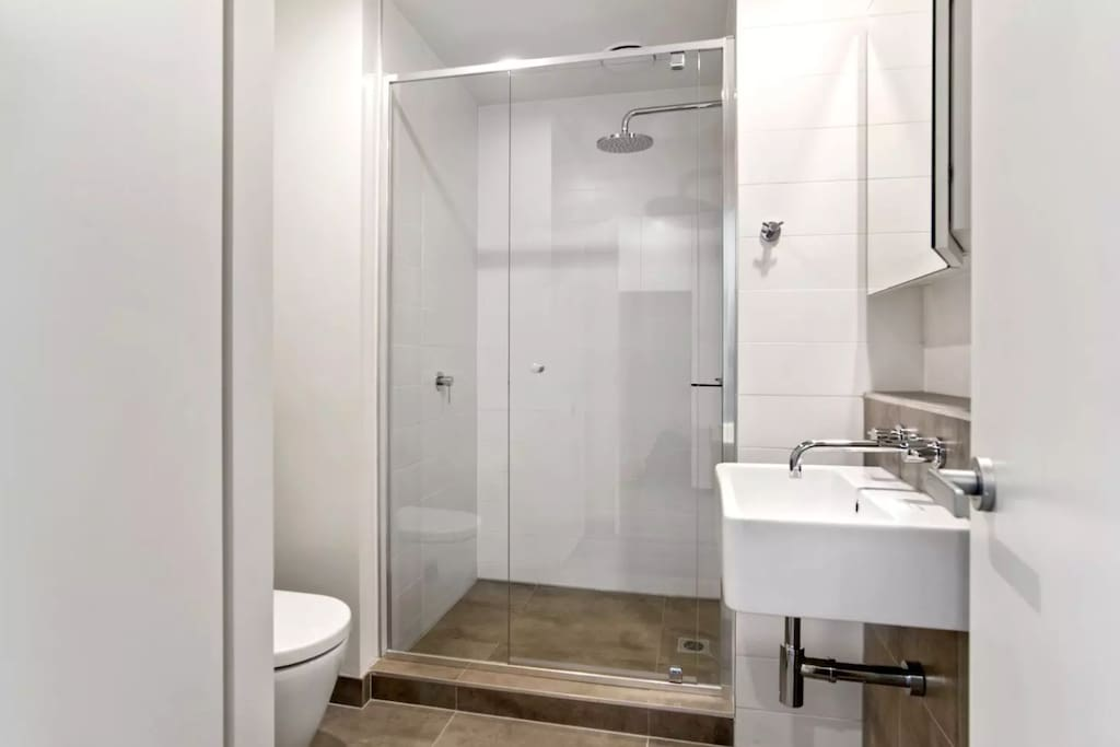 Private Bathroom with towels and shampoo.