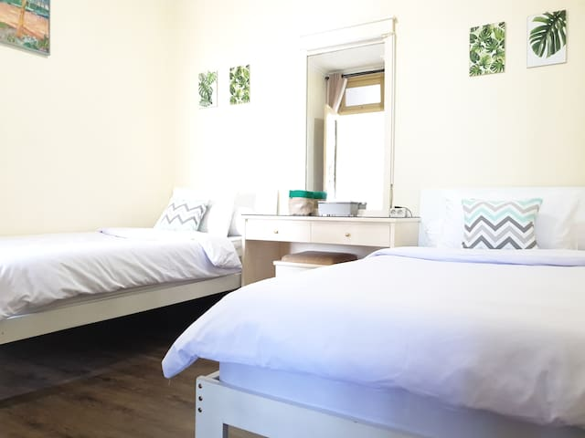 Second bedroom with 2 single beds. Towels are also provided.