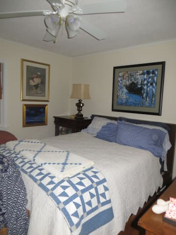 Guest bedroom with queen sized bed.  Full bathroom directly across the hall.