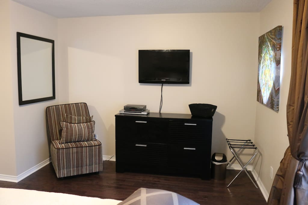 Small seating area with tv and dvd player.