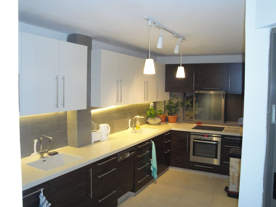 Modern kitchen with two ovens , hob , large fridge , kettle , toaster and everything is new !