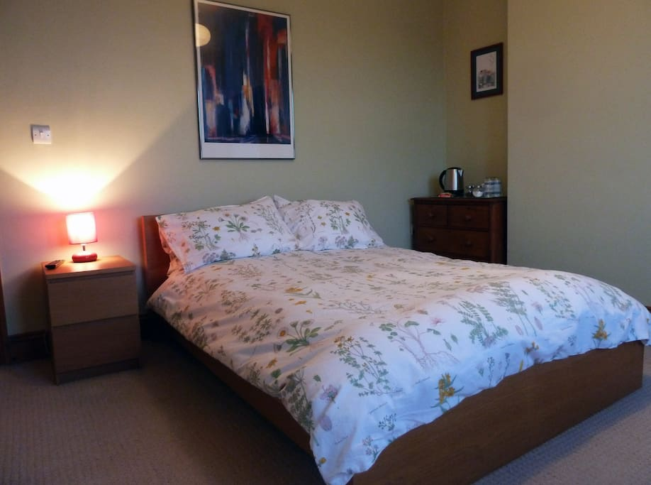 Spacious en-suite double bedroom with great views