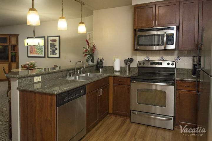 Full Kitchen with stove, microwave, dishwasher and bar seating. Plus, you have your own washer and dryer.