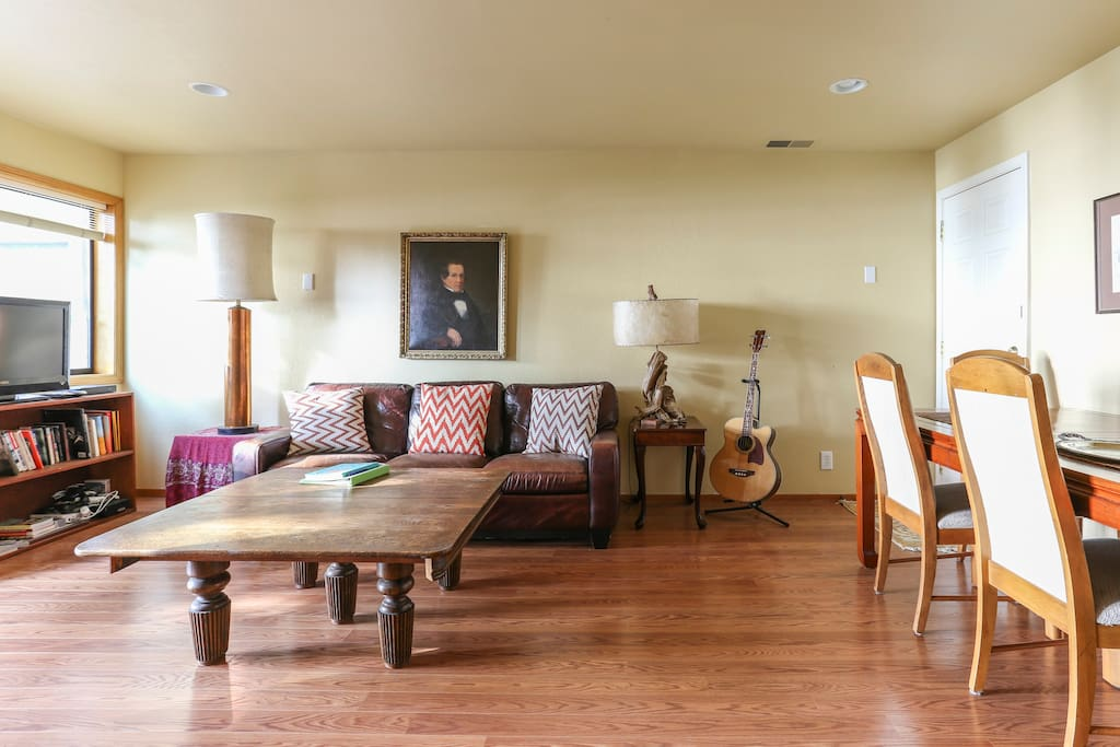 Entertainment/ Dining Room with a game chest, smart TV with Netflix; and a bass guitar!