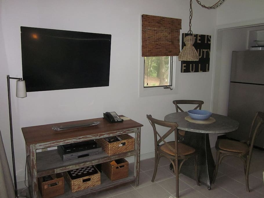 Large flat screen with HD cable.  The TV can be viewed from the screened porch.