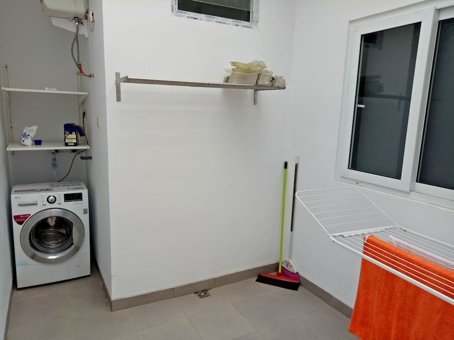 Backyard with open air circulation and washing machine, hanger for drying