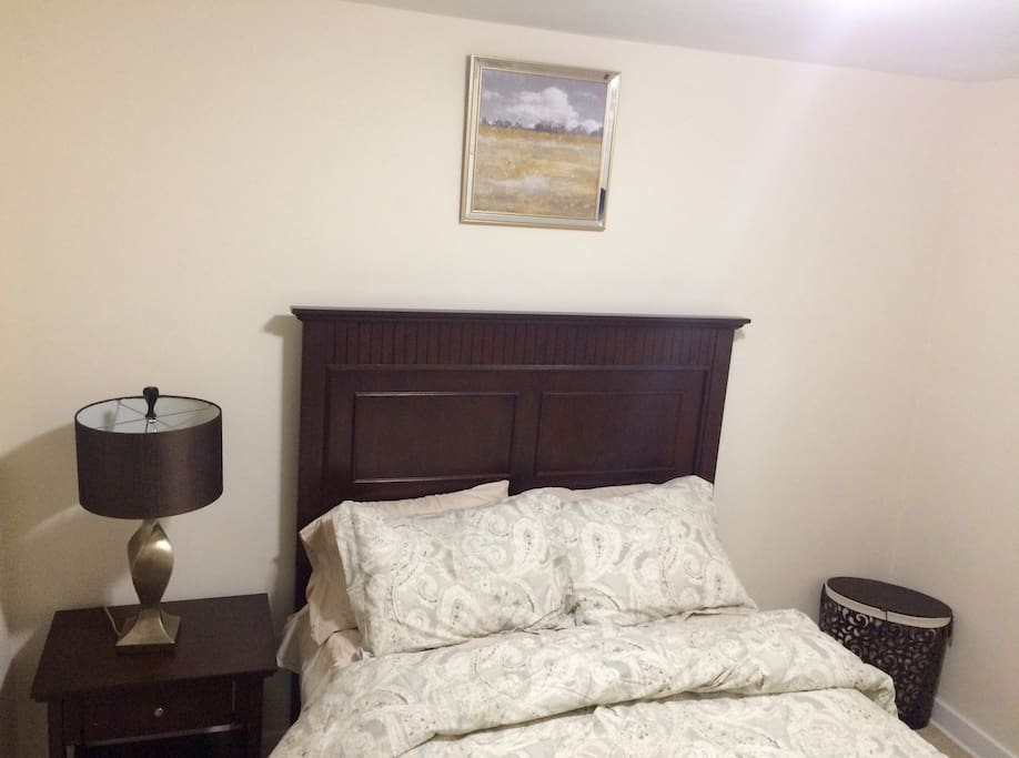 Full sized storage bed with 6 drawers, nightstand, reading lamp, and a hamper.