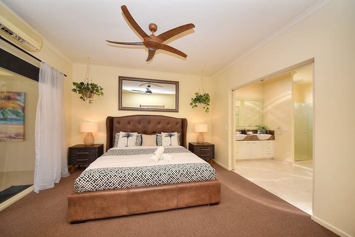 Master Bedroom with A/C and ceiling fan has its own ensuite, robe and direct access to pool/gazebo area.