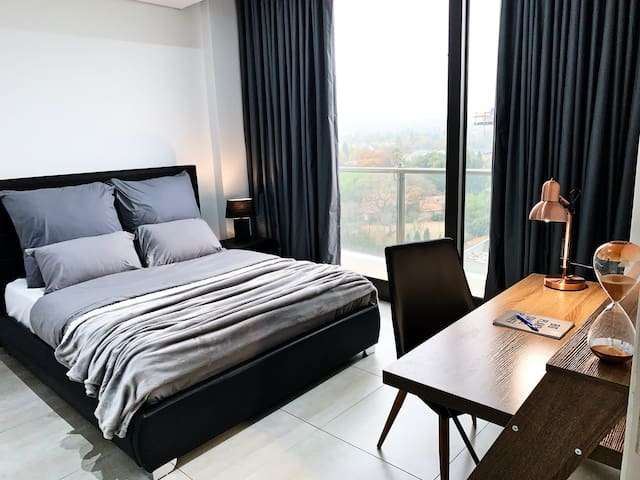 A spacious bedroom with a phenomenal view.