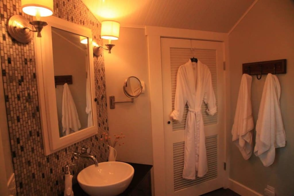 cozy robes, fluffy towels provided for luxurious comfort