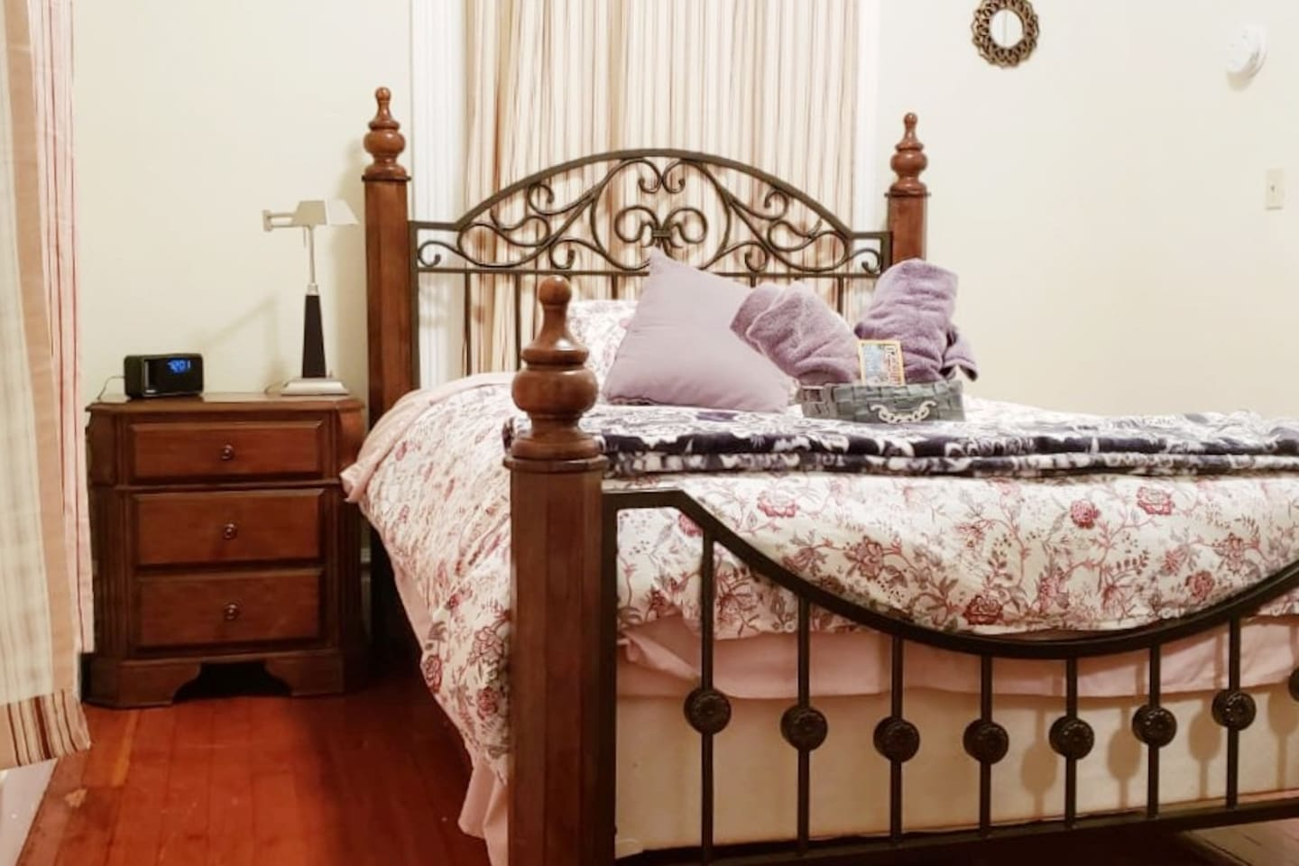 Norman's Quarters has a lovely Victorian wood and metal queen size bed.