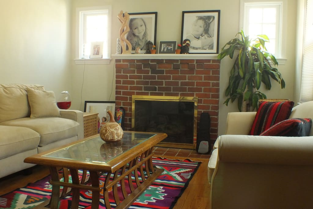 Living room with a working fireplace -- cozy!