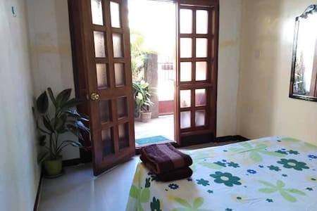 Long Beach Home Stay - Alimanguan (AC-room)