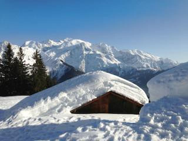 Snowshoeing above the chalet