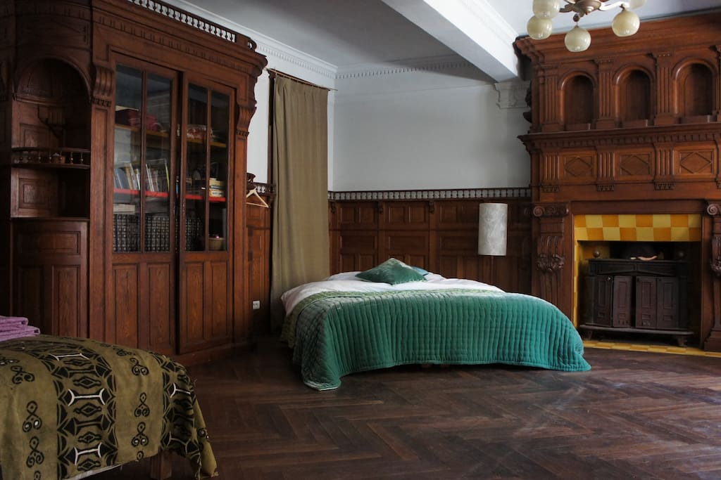 Large wood pannelled room with verious sleeping options