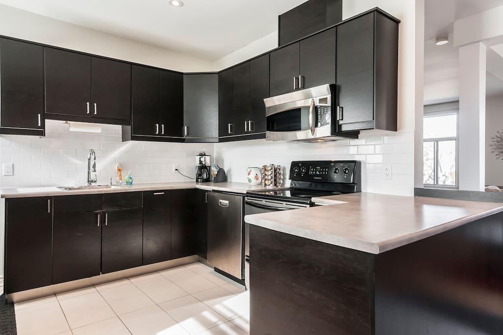 Fully functional kitchen. Large dishwasher, microwave, wine fridge