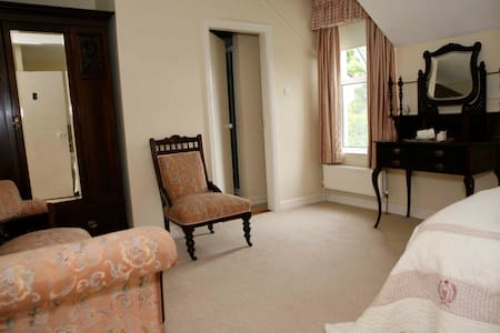 Lovely ensuite room with a queen size bed and tea or coffee making facilities.