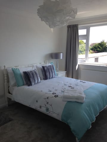 Bedroom One with a double bed