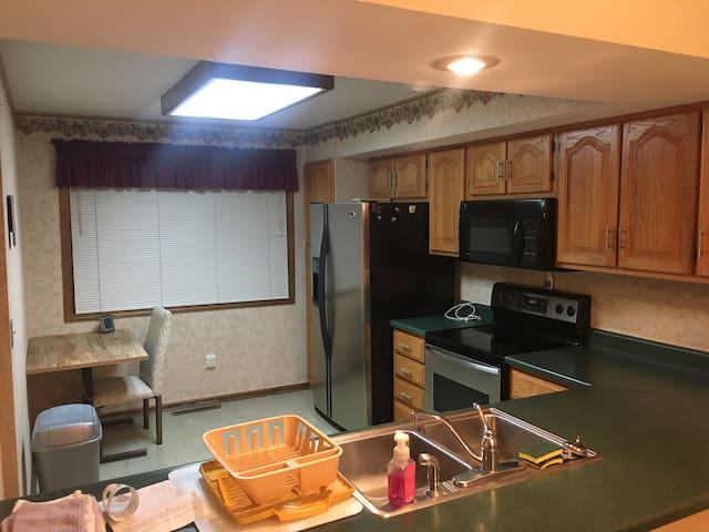 Small eat-in area in kitchen, as well as formal dining area.