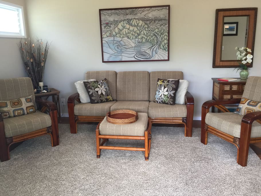 Living room, designer tropical furnishings, local artwork