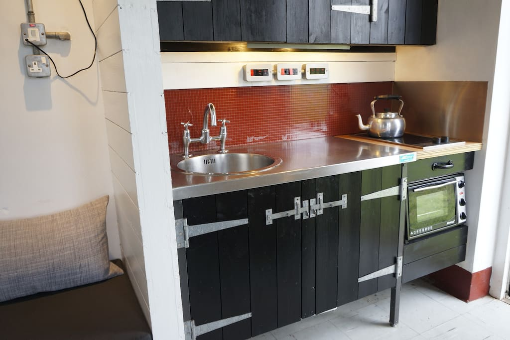 The kitchen has all the essentials including a small oven and fridge. There's also a stove top espresso pot.