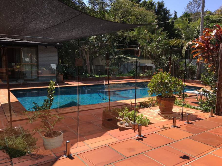 View of the pool from the main house back door, looking at the part of the Guest house behind
