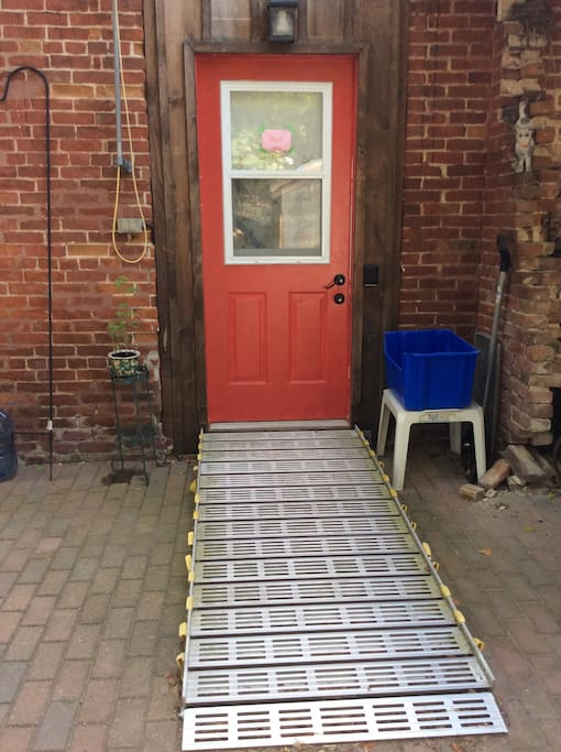 Back Door with Lock Box and Wheelchair ramp.