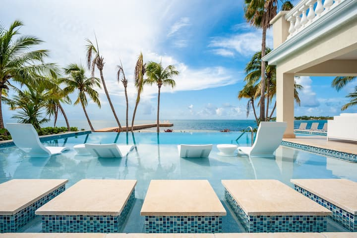 Crystal Waters: Gorgeous Barefoot Beach w/ New Pool & Private Dock in Cayman Kai