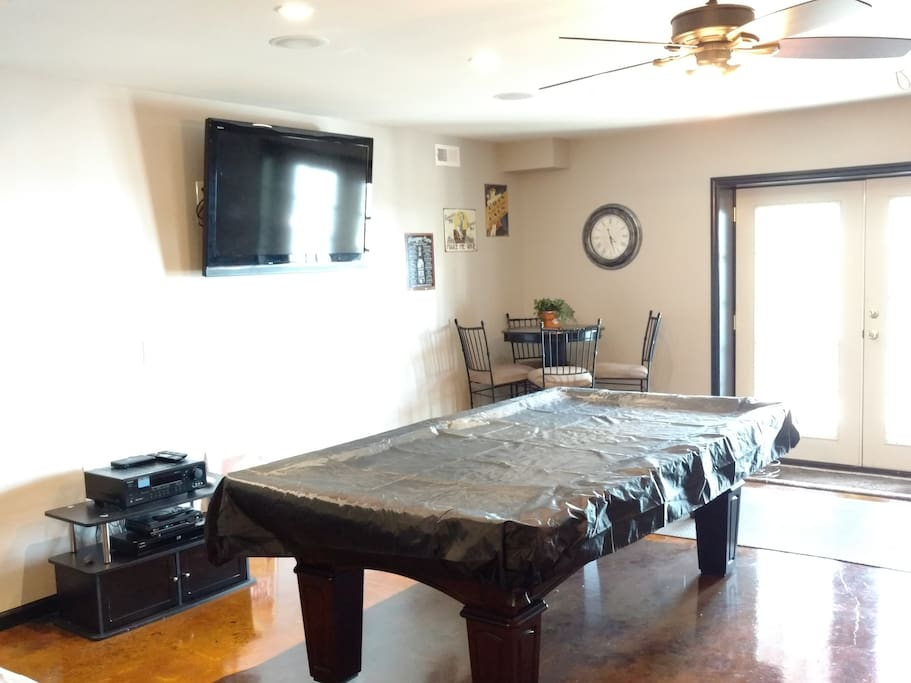 Common area,Pool table, TV, Love seat opens to Lake and patio.