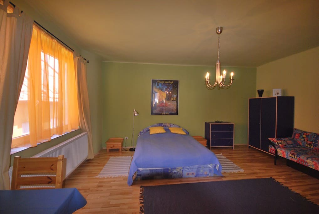 Master bedroom with queen size bed, plus single bed