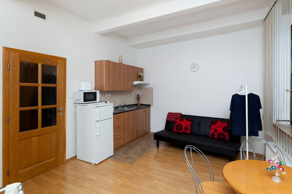 Small fully equipped kitchennet and a table for 3 persons
