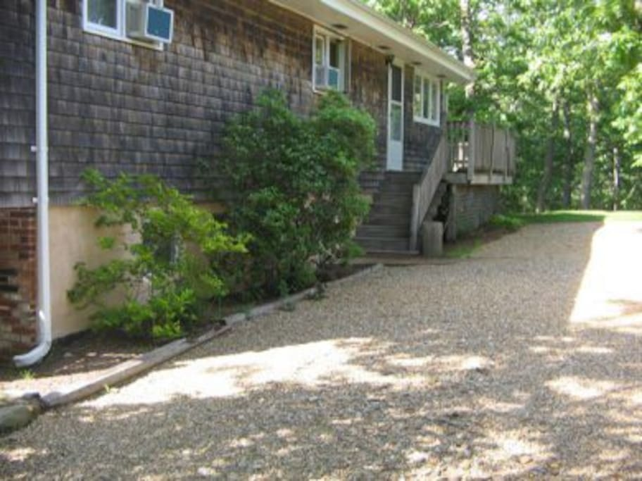 Private driveway and entrance to condo. Can accommodate two cars end to end....