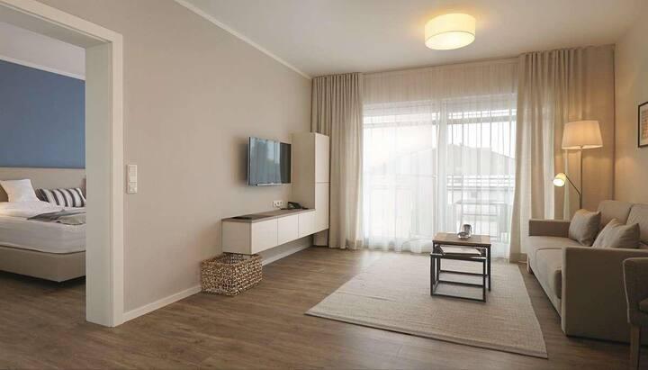 App. Hotel Fidelio (Bad Füssing), Penthouse 2 (67qm) mit Dachterrasse, Boxspringbett und vollausgestatteter Küche