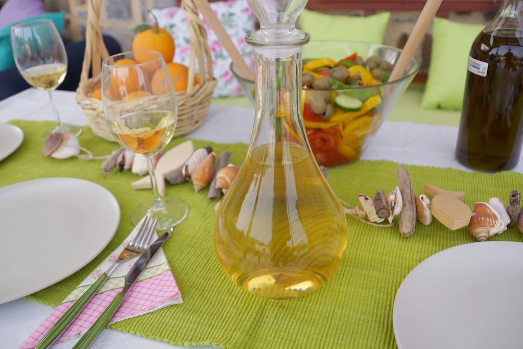 You are welcome to our home and we offer you wine and olive oil from our place.
