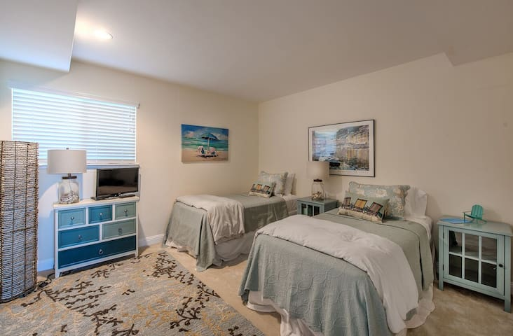 Guest bedroom can be a king bed with memory foam topper or two twins and an HDTV.